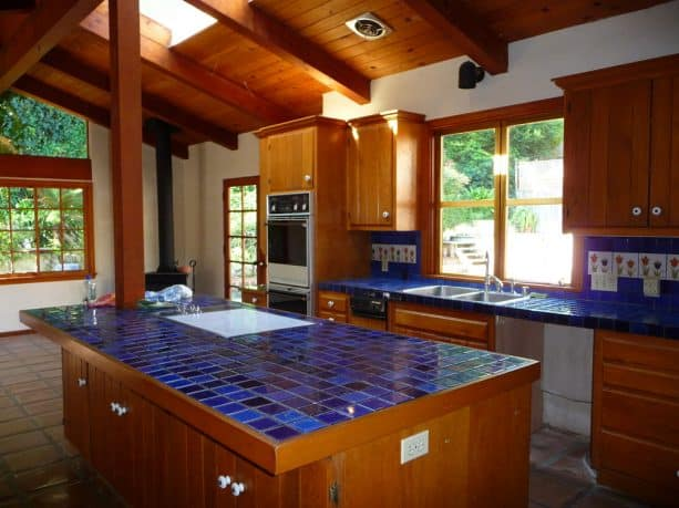 before the remodel the kitchen had these blue tiles