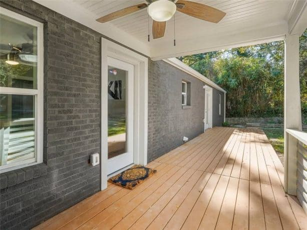 grey painted ranch house exterior with white windows and doors