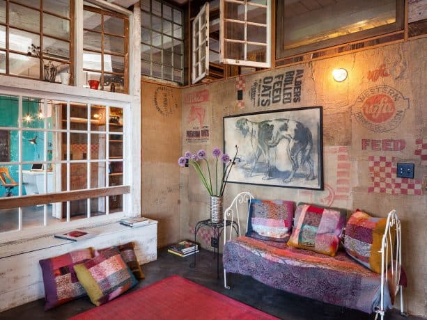 gorgeous eclectic interior with opening reclaimed windows on the upper wall