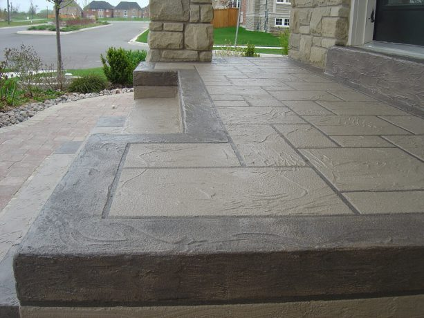 the detailed look of the new two-tone front concrete steps