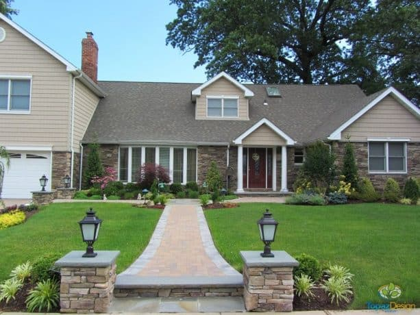 red brick front walkway landscaping idea with simply grey paver edges as highlight