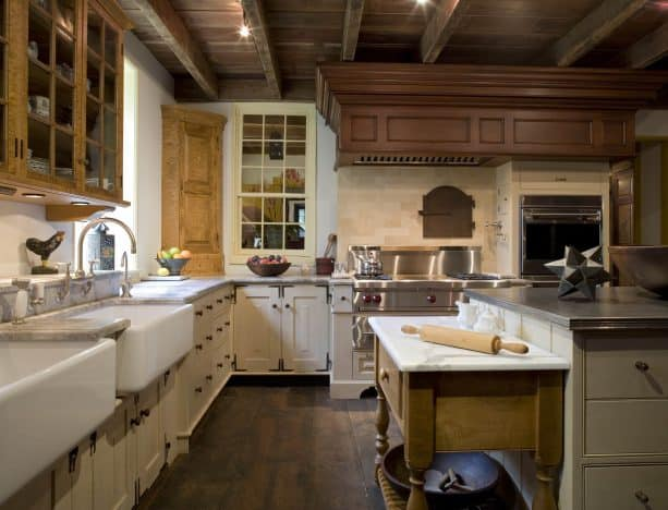 cream cabinets paired with repurposed hardwood floor and ceiling
