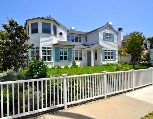 remarkable coastal-style white exterior house with sky-blue window shutters