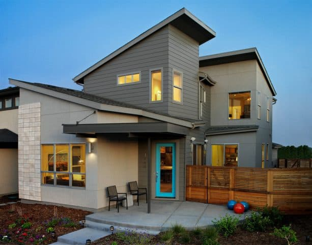 a dark grey contemporary exterior with turquoise entry