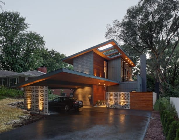 a contemporary carport that has breeze block wall instead of posts as the support