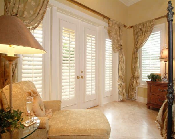 plantation shutters as an elegant detailing of a traditional bedroom