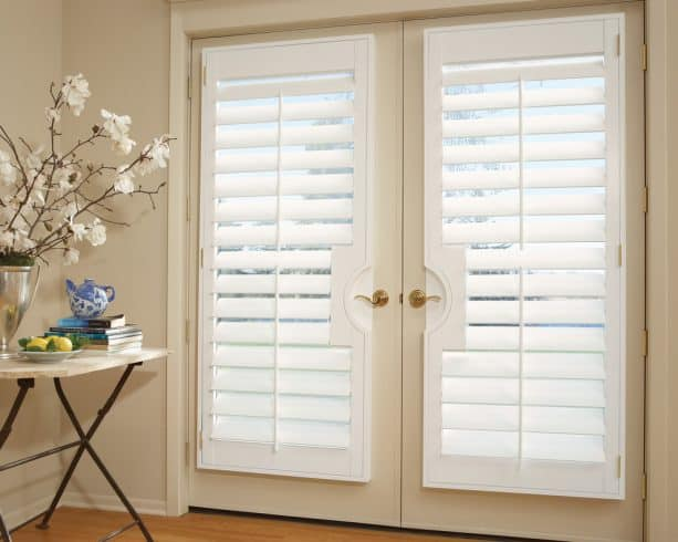 white vinyl plantation shutters on a warm white French doors