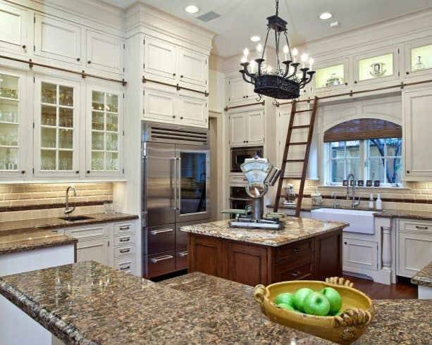 antique white kitchen cabinets paired with copper brown granite countertops