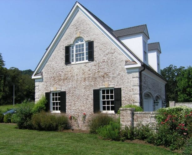 exterior with lime-washed brick wall