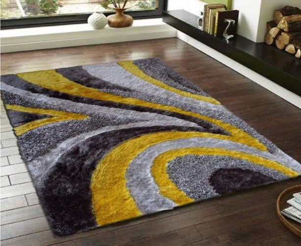 modern grey and yellow area rug with swirl-like pattern