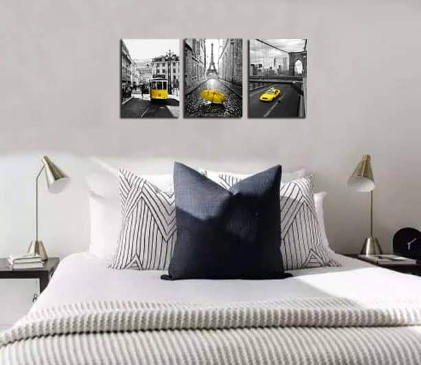 yellow and gray-themed panel wall art in a modern bedroom