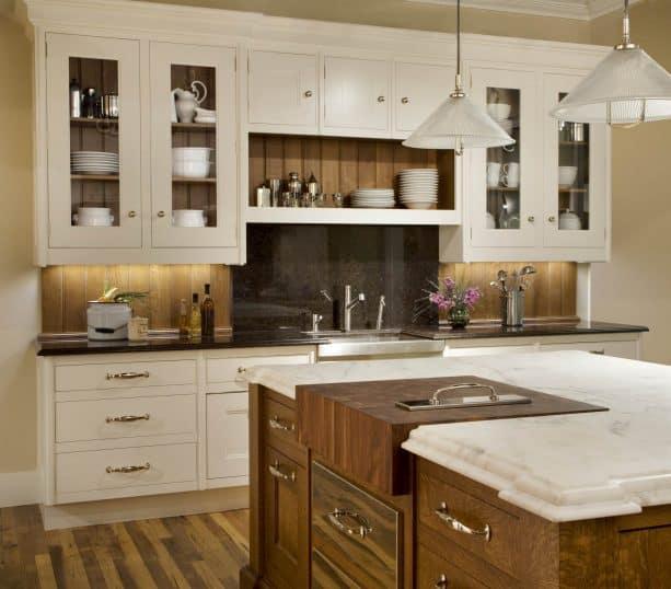 darker wood backsplash paired with cream kitchen cabinets