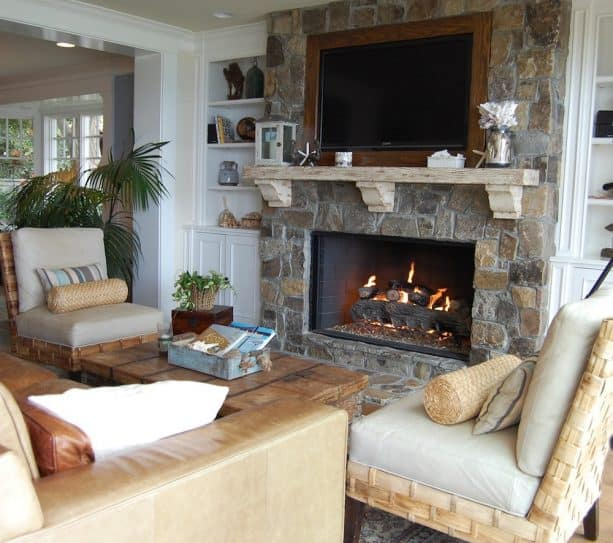 canyon creek stone fireplace with neutral colored built-in shelves around