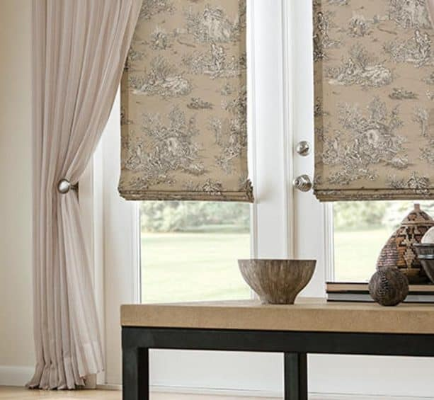 elegant-patterned blackout roman shade in flat style covering French doors