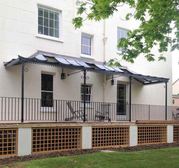 a victorian style porch will benefit a lot from small wrought iron columns