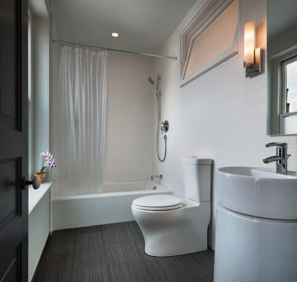 a contemporary bathroom with indoor tilting window on the top part of the wall