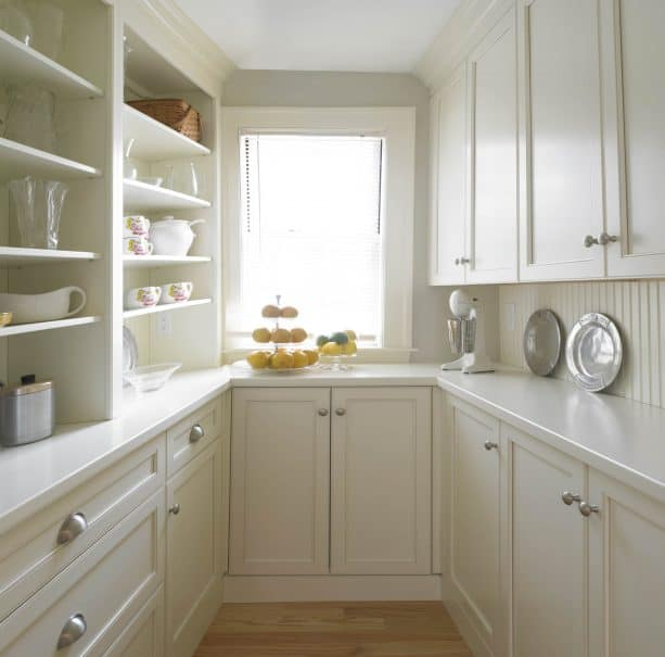 a cozy kitchen design with vertical stripes warm white wood backsplash and cabinets