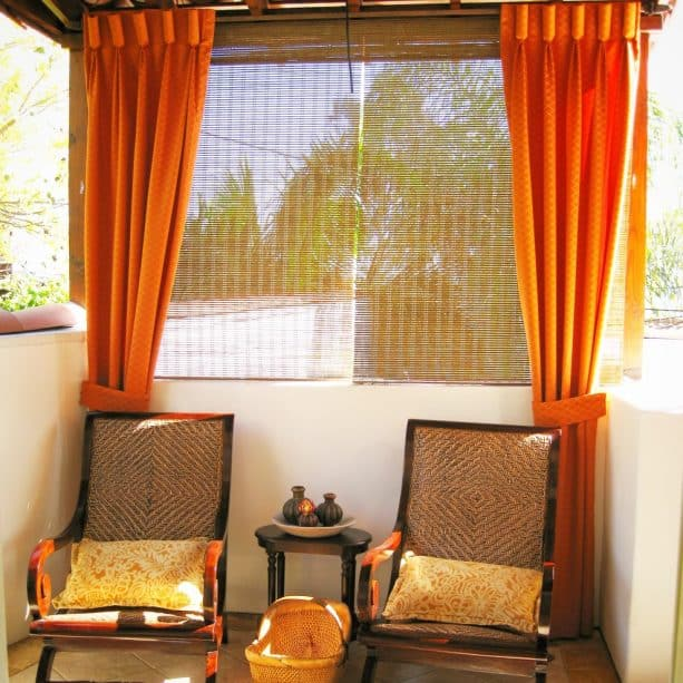 Mediterranean patio with bamboo blinds at the back