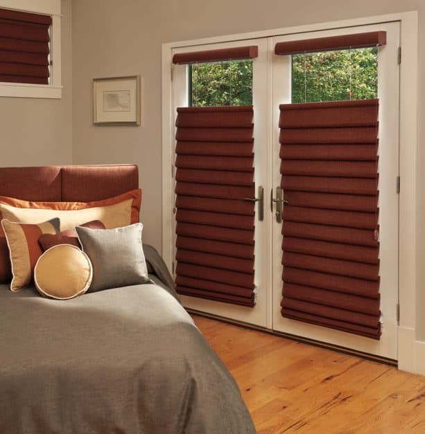 French doors with brown blackout roman shade in top down bottom up style