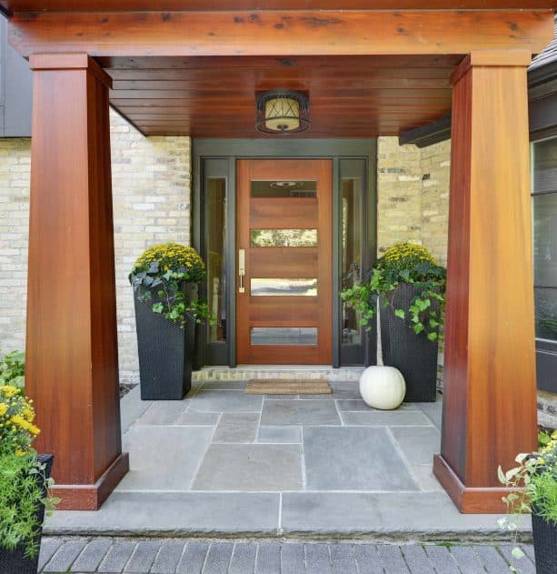 contemporary front door with brown stain and black trim