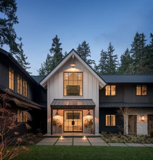 a two-tone modern farmhouse exterior with Black Panther 2125-10 and White Heron OC-57