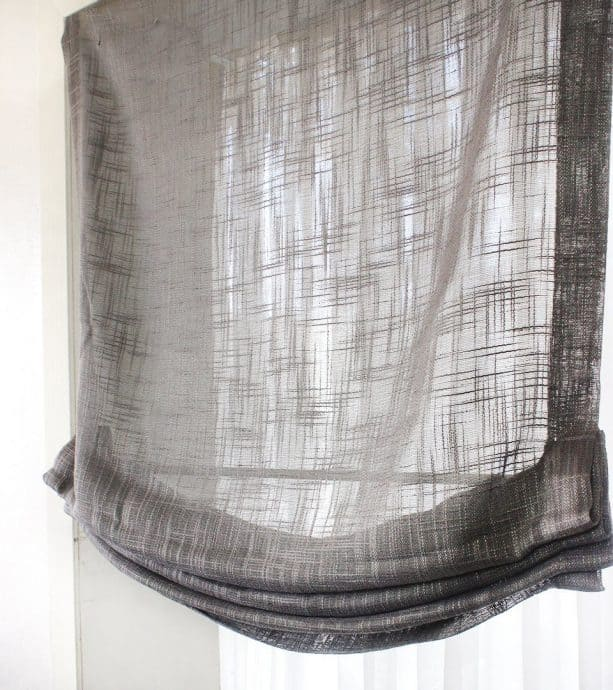 sheer grey linen relaxed roman shade to cover French door
