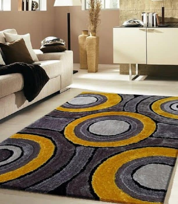 modern grey and yellow area rug with round pattern