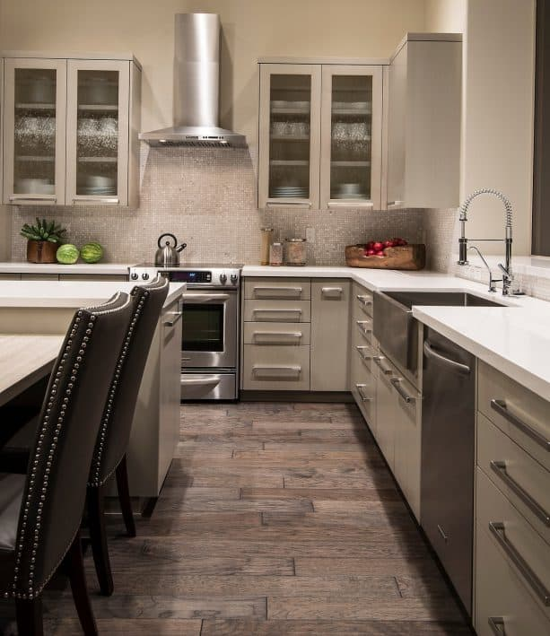off-white kitchen cabinets paired with stainless-steel appliances