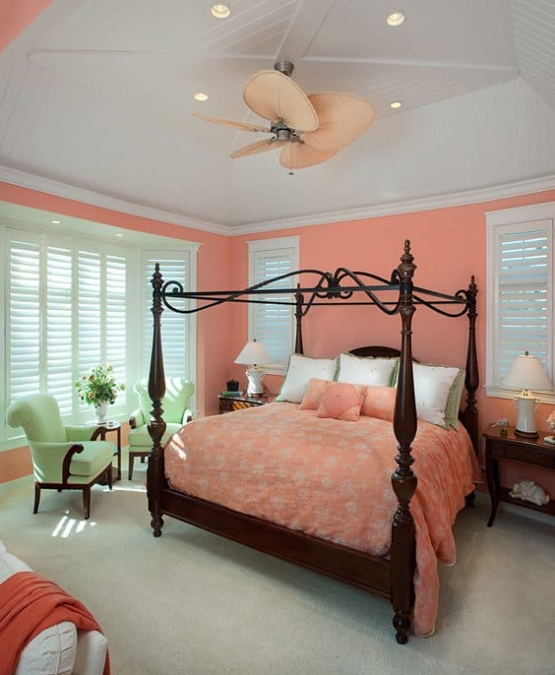 pink and grey bedroom with elegant wooden bed and canopy frame
