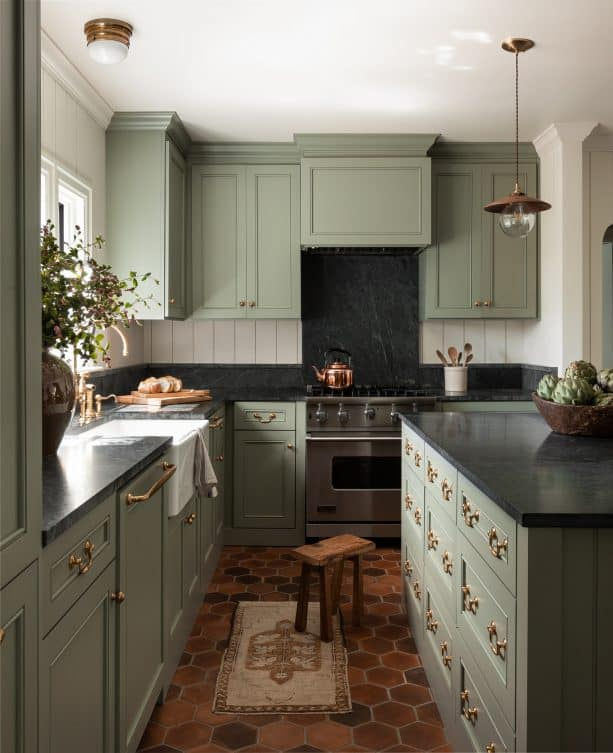a kitchen interior with sage green and white color scheme