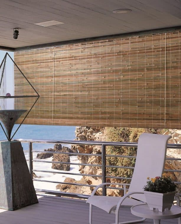 the use of roll-up bamboo blind in a beach house balcony