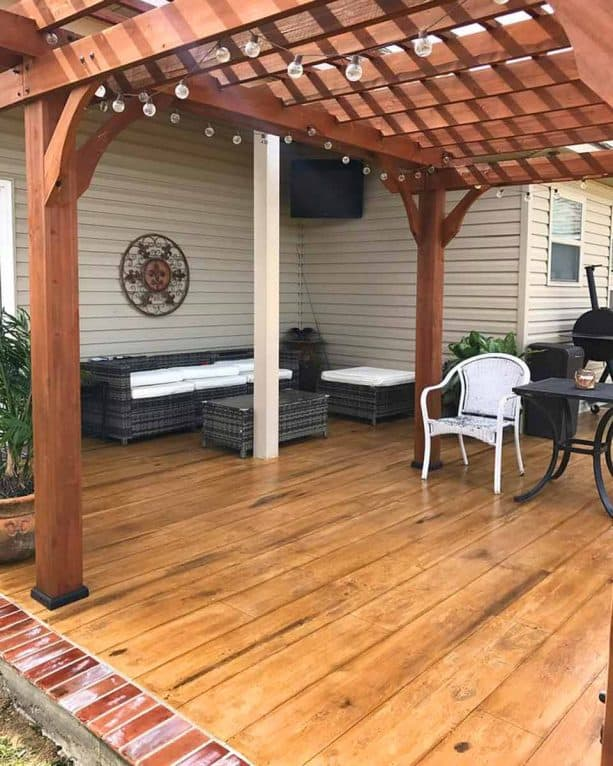 the use of concrete wood floor under a roofed patio