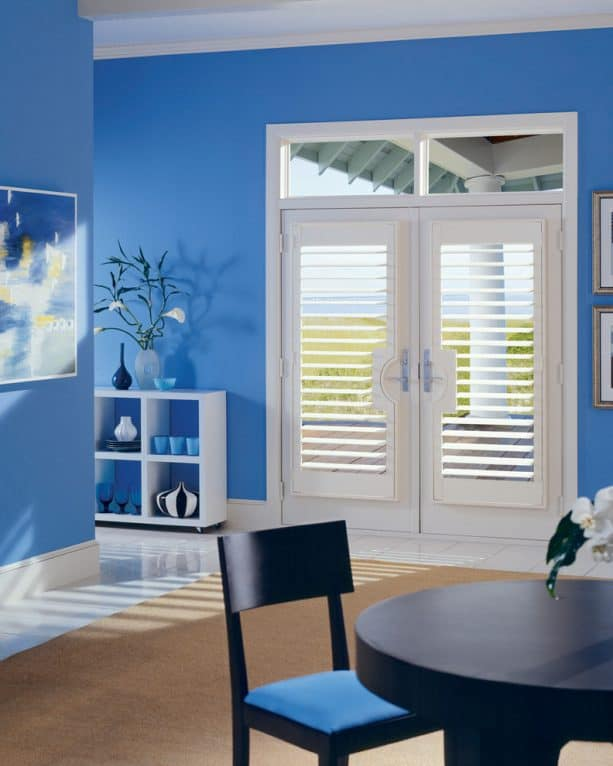 white Hunter Douglas plantation shutter to create a beach style on white French doors