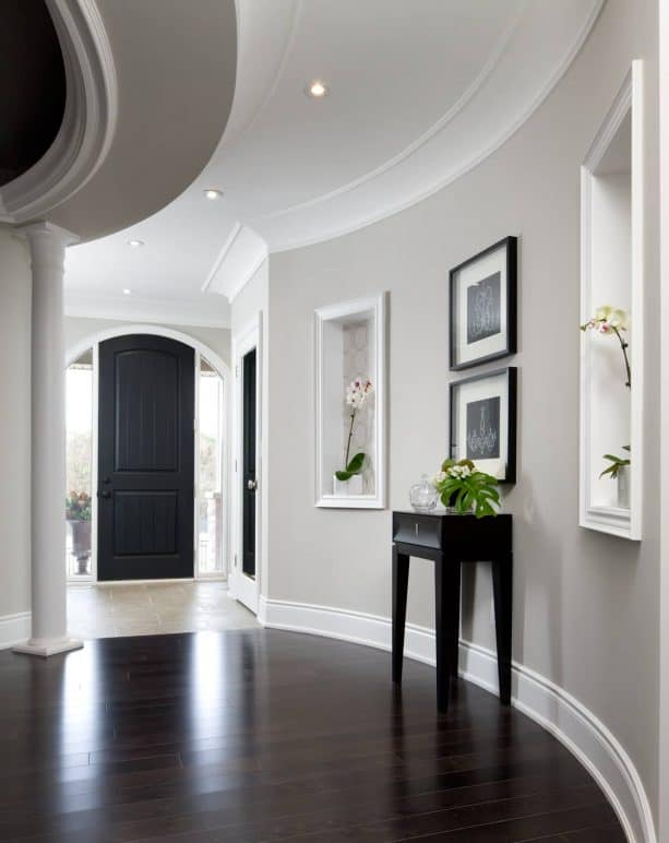 a hallway with light grey paint and white trim