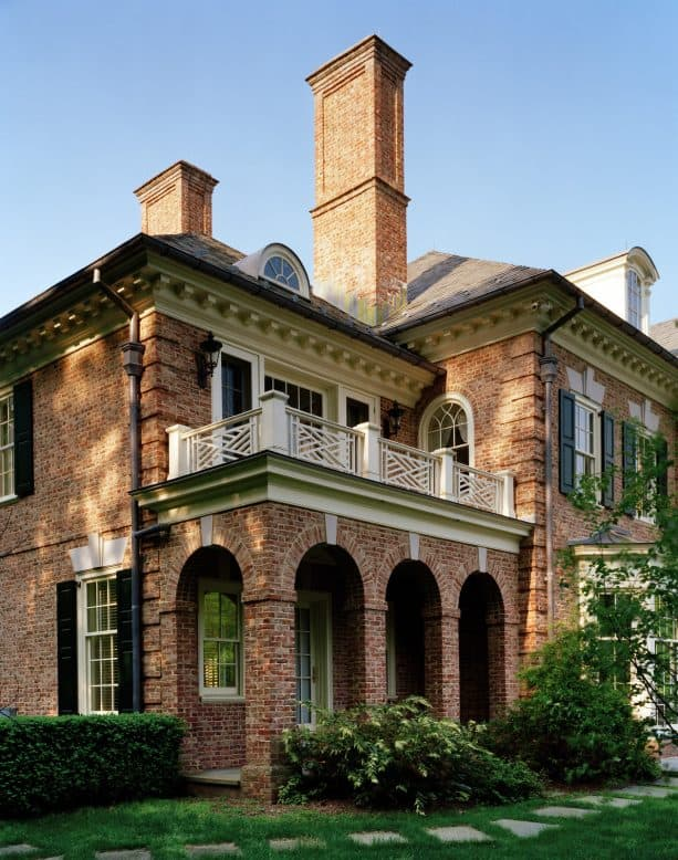 georgian house with brick exterior and leaf green shutters