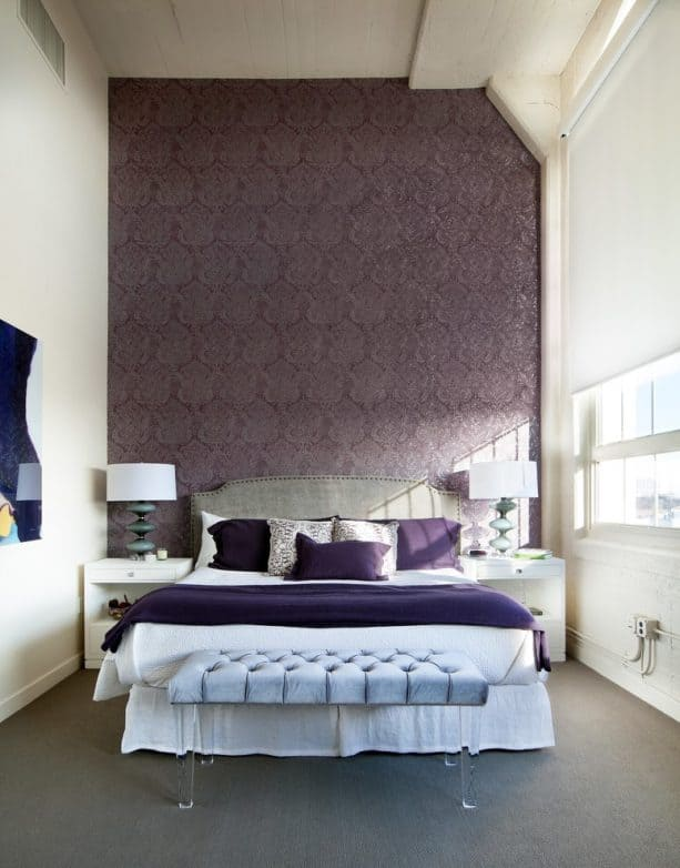 purple and grey bedroom with elegant-patterned purple accent wall