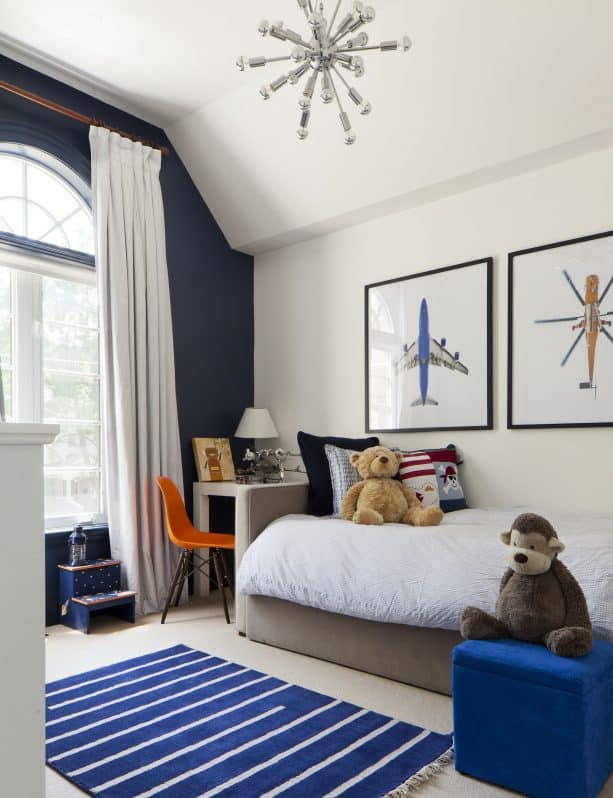 a kid's room with navy blue and beige color scheme
