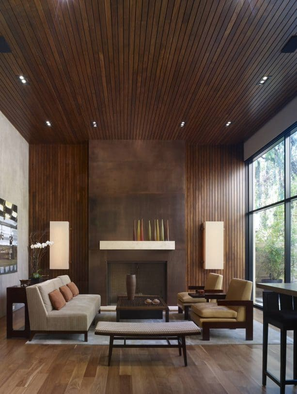 grey and brown living room with floor to ceiling fireplace