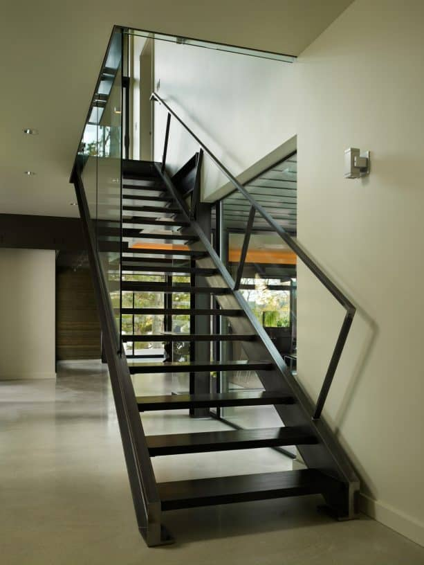 all-black open staircase design for basement area
