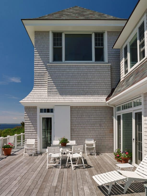 a light grey shingle siding exterior with whitewashed deck