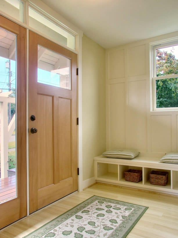 a traditional front door with single sidelight and simple transom window above it