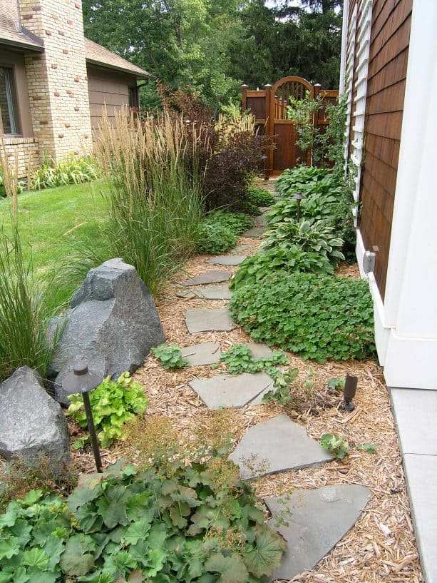 pathway landscape from wood chips mulch and stepping stones
