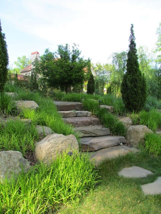 mediterranean hillside slope landscaping with colonial steppers stone steps