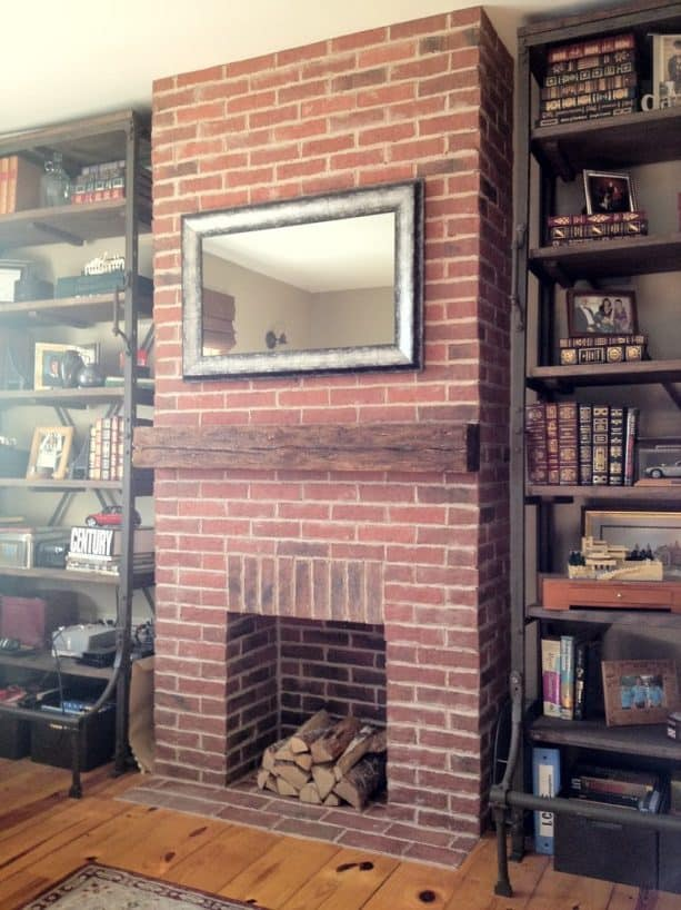 a fireplace covered in thin brick tiles in a traditional family room