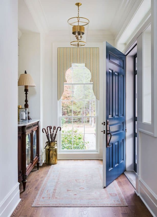 a front door with semi-glossy navy blue paint