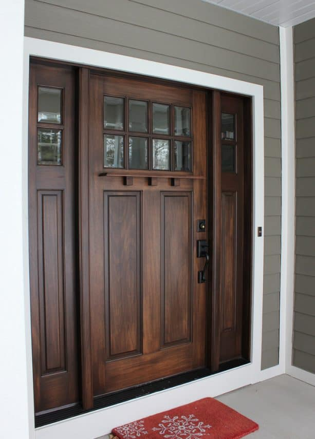 a walnut-stained door with white trim