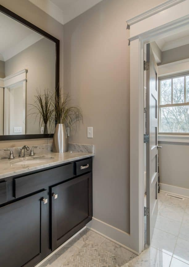 transitional bathroom with Sherwin-Williams colonnade gray SW 7641 warm gray wall paint color
