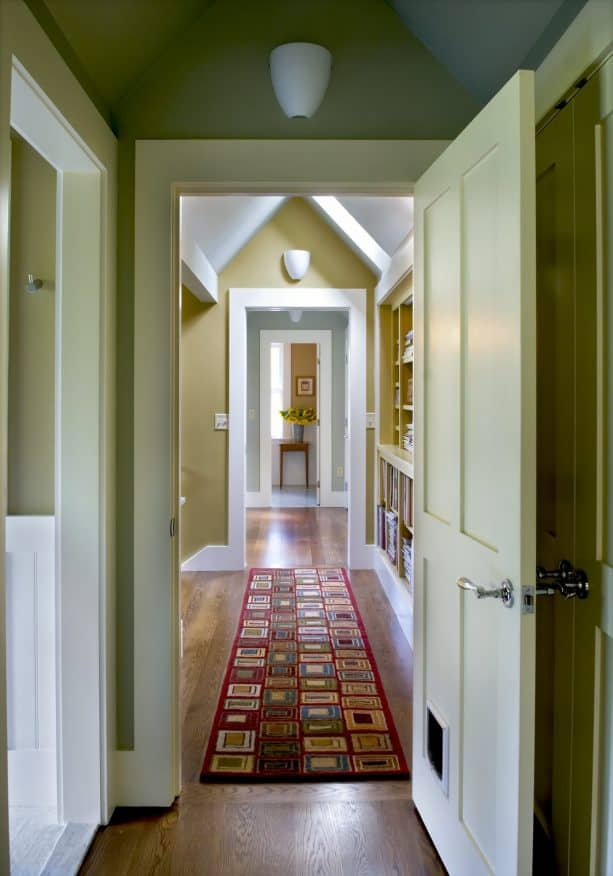 hallway with golden color and white trim