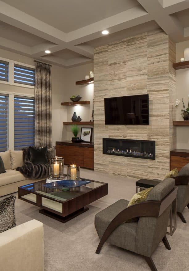 trendy carpeted living room with floating built-in shelves around fireplace feature