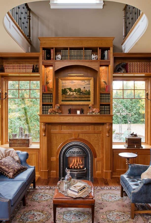 victorian medium tone wood fireplace with built-in shelves and cabinets
